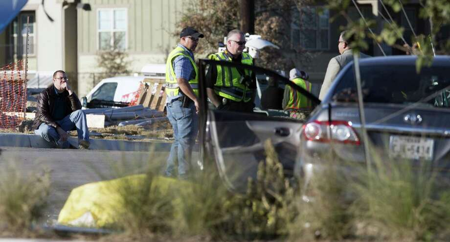 Emergency personnel examine the scene Wednesday, Dec. 21, 2016 in the 11200 block of Alamo Ranch Parkway, near the intersection of Texas 151 and Loop 1604, where a two vehicle crash left three people dead. One person died at the scene of the crash and two more people were transported to the hospital where they later died. The driver and two passengers of one vehicle died. The driver of the second vehicle appeared to suffer only minor injuries and was not taken to a hospital. Photo: William Luther, Staff / San Antonio Express-News / © 2016 San Antonio Express-News