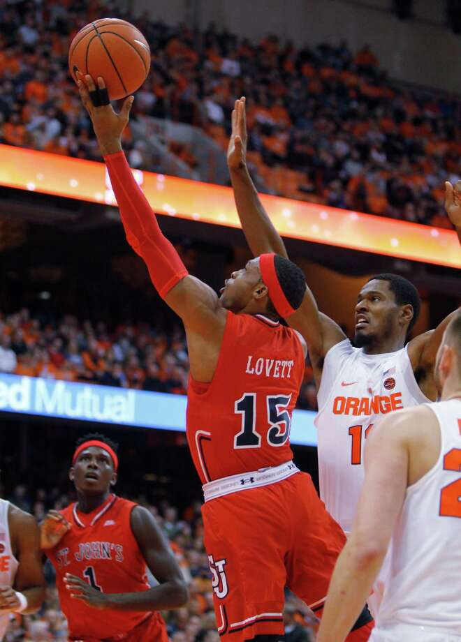 St. John's Marcus Lovett, left, shoots past Syracuse's Taurean Thompson, right, in the first half an NCAA college basketball game in Syracuse, N.Y., Wednesday, Dec. 21, 2016. (AP Photo/Nick Lisi) ORG XMIT: NYNL104 Photo: Nick Lisi / FR171024 AP
