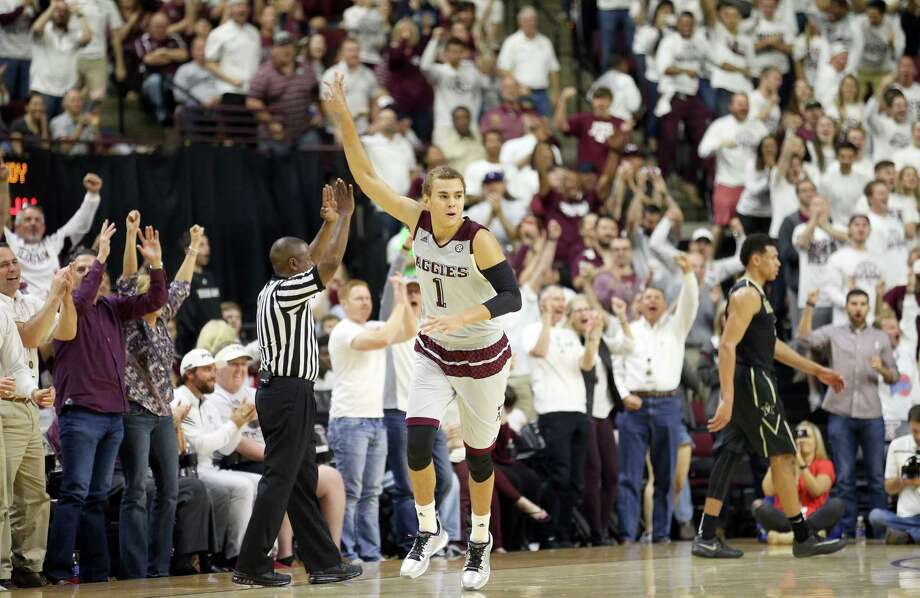 Texas A&M's D.J. Hogg (1) reacts after making a 3-point basket against Vanderbilt during the second half of an NCAA college basketball game, Saturday, March 5, 2016, in College Station, Texas. Texas A&M won 76-67. Photo: Sam Craft, AP / FR145148 AP