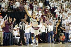 Texas A&M's D.J. Hogg (1) reacts after making a 3-point basket against Vanderbilt during the second half of an NCAA college basketball game, Saturday, March 5, 2016, in College Station, Texas. Texas A&M won 76-67.