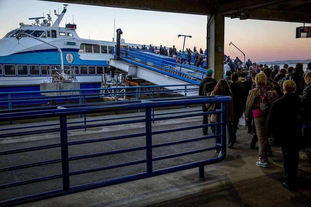 FILE-- People board to ride the 5 p.m. ferry heading to Larkspur at the Golden Gate San Francisco Ferry Terminal behind the Ferry Building on Wednesday, Dec. 21, 2016 in San Francisco. City, port and ferryboat officials broke ground Thursday on a $79 million project to build two San Francisco ferry docks that mark a major expansion of water transportation. Photo: Santiago Mejia, The Chronicle