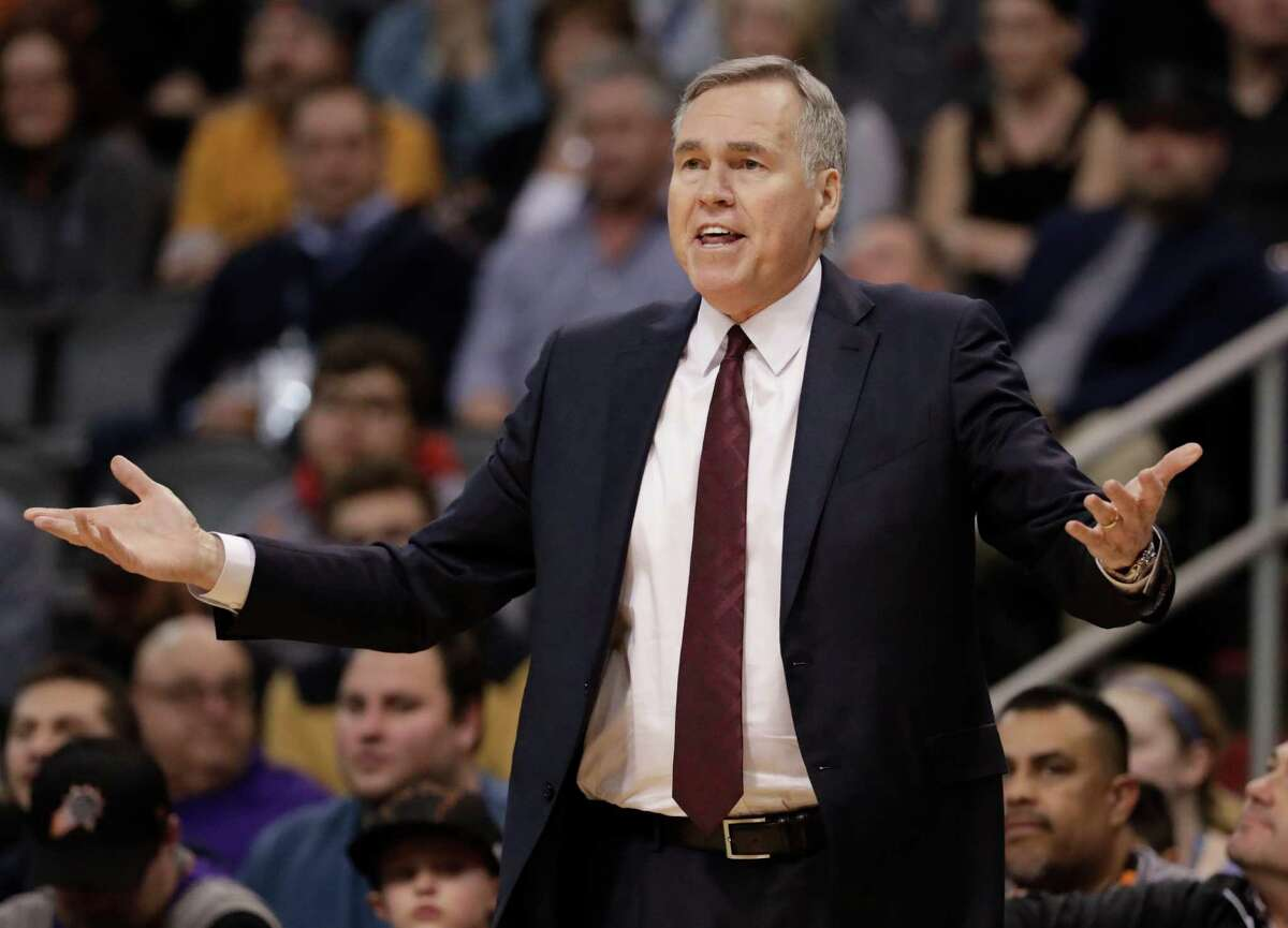 Houston Rockets coach Mike D'Antoni gestures during the first half of the team's NBA basketball game against the Phoenix Suns, Wednesday, Dec. 21, 2016, in Phoenix. (AP Photo/Matt York)