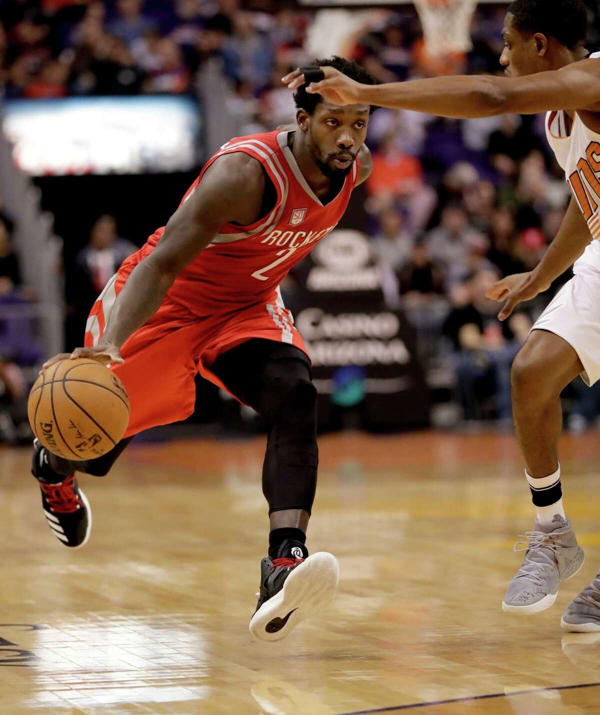 Houston Rockets guard Patrick Beverley (2) drives past Phoenix Suns guard Brandon Knight during the first half of an NBA basketball game, Wednesday, Dec. 21, 2016, in Phoenix. (AP Photo/Matt York)