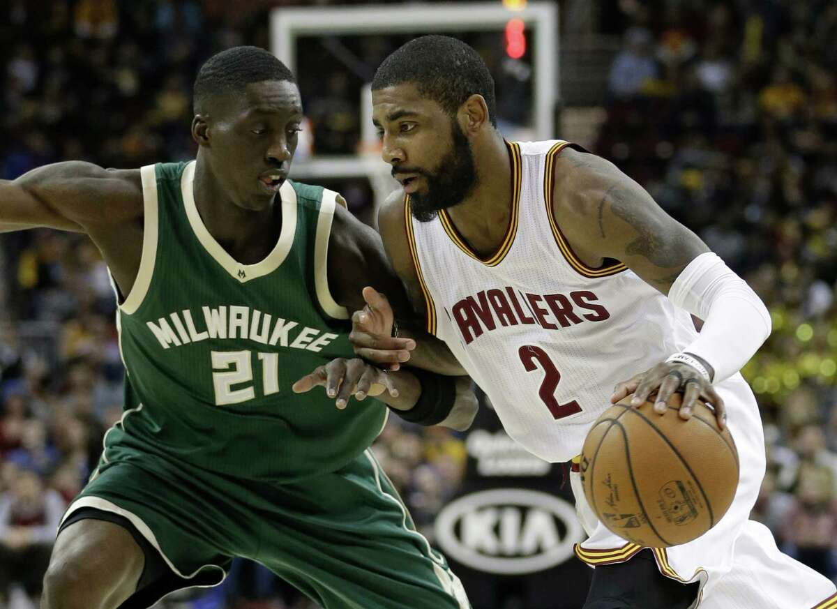 Cleveland Cavaliers' Kyrie Irving (2) drives past Milwaukee Bucks' Tony Snell (21) during the first half of an NBA basketball game, Wednesday, Dec. 21, 2016, in Cleveland. (AP Photo/Tony Dejak) ORG XMIT: OHTD105