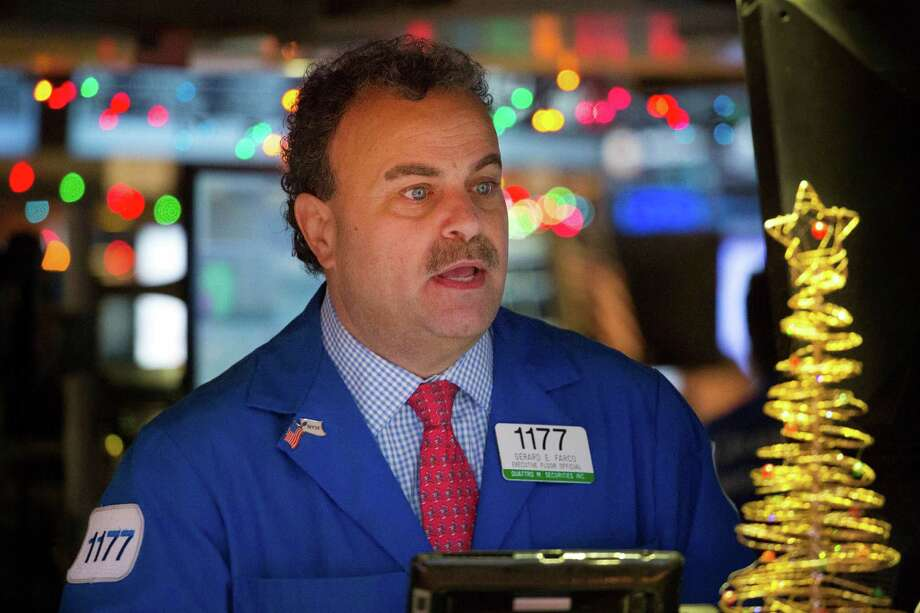 Gerard Farco follows stock prices at the New York Stock Exchange, Wednesday, Dec. 21, 2016, in New York. The Dow is close to the 20,000 mark. (AP Photo/Mark Lennihan) Photo: Mark Lennihan, STF / Copyright 2016 The Associated Press. All rights reserved.