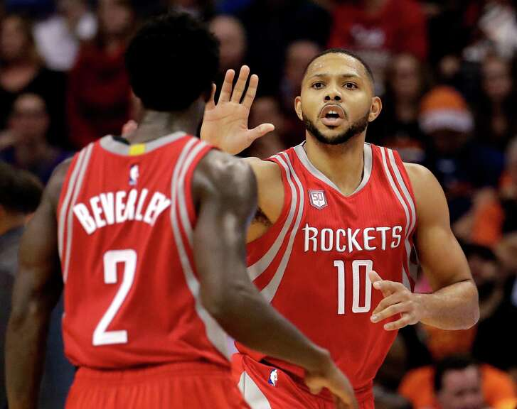 Houston Rockets guard Eric Gordon (10) celebrates his basket against the Phoenix with guard Patrick Beverley (2) Suns during the second half of an NBA basketball game, Wednesday, Dec. 21, 2016, in Phoenix. (AP Photo/Matt York)