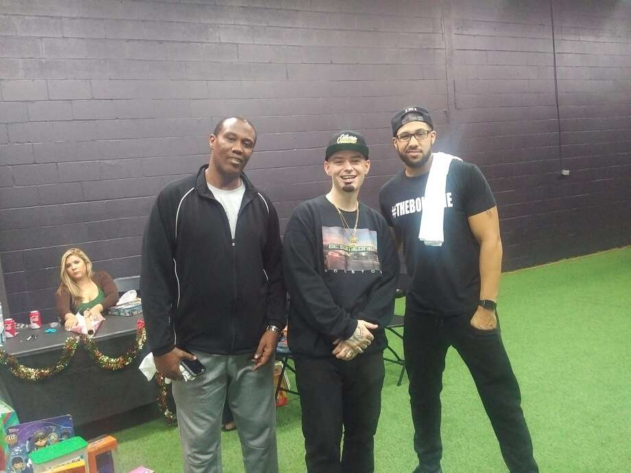 Carl Foster, Paul Wall and Abdul Foster at holiday charity event at IX Innovations. Photo: Aaron Wilson
