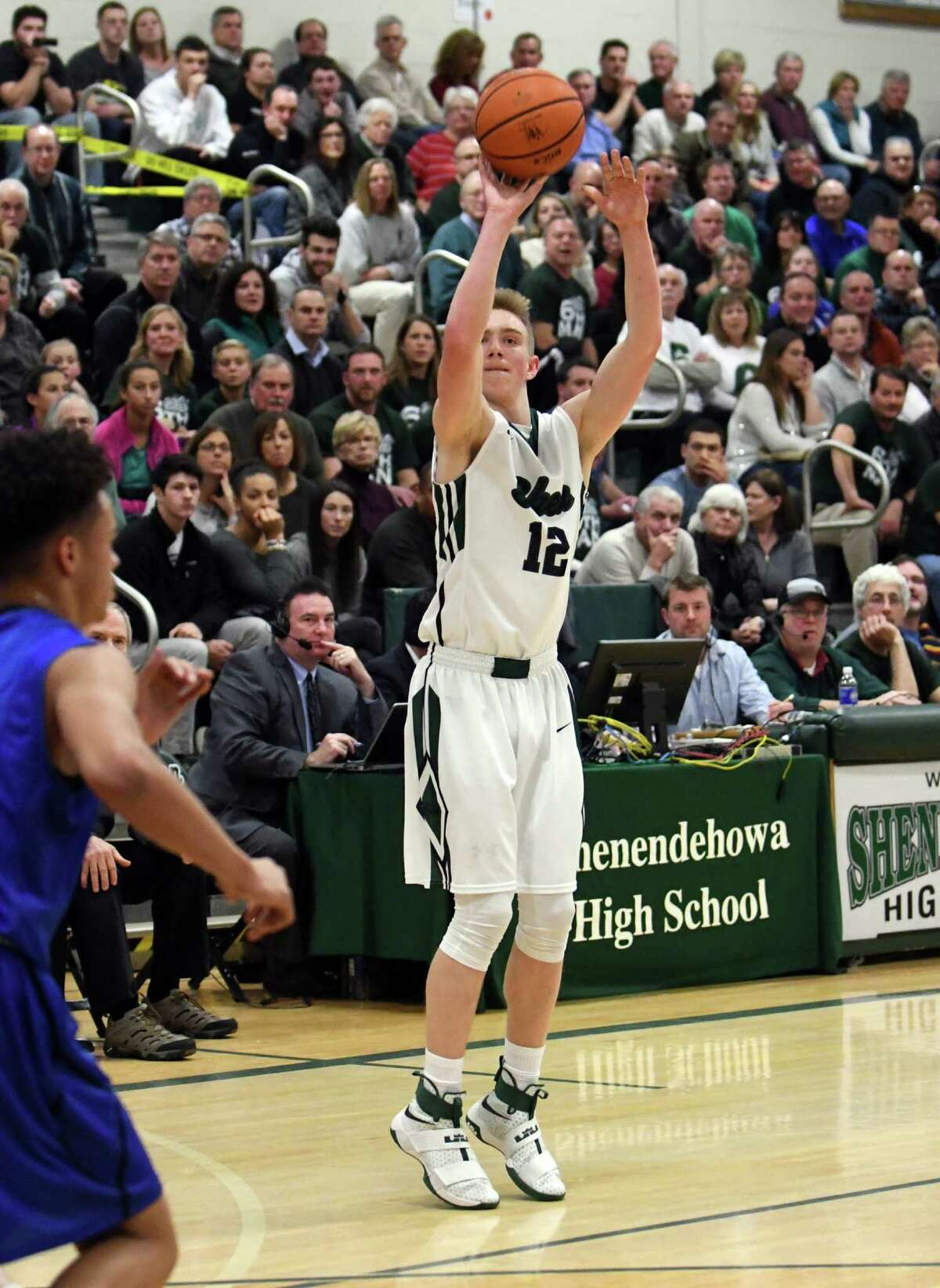 Shen's Jaia Benson puts up a three point shot during their boy's high school basketball game against Saratoga on Wednesday Dec. 21, 2016 in Clifton Park, N.Y. (Michael P. Farrell/Times Union)