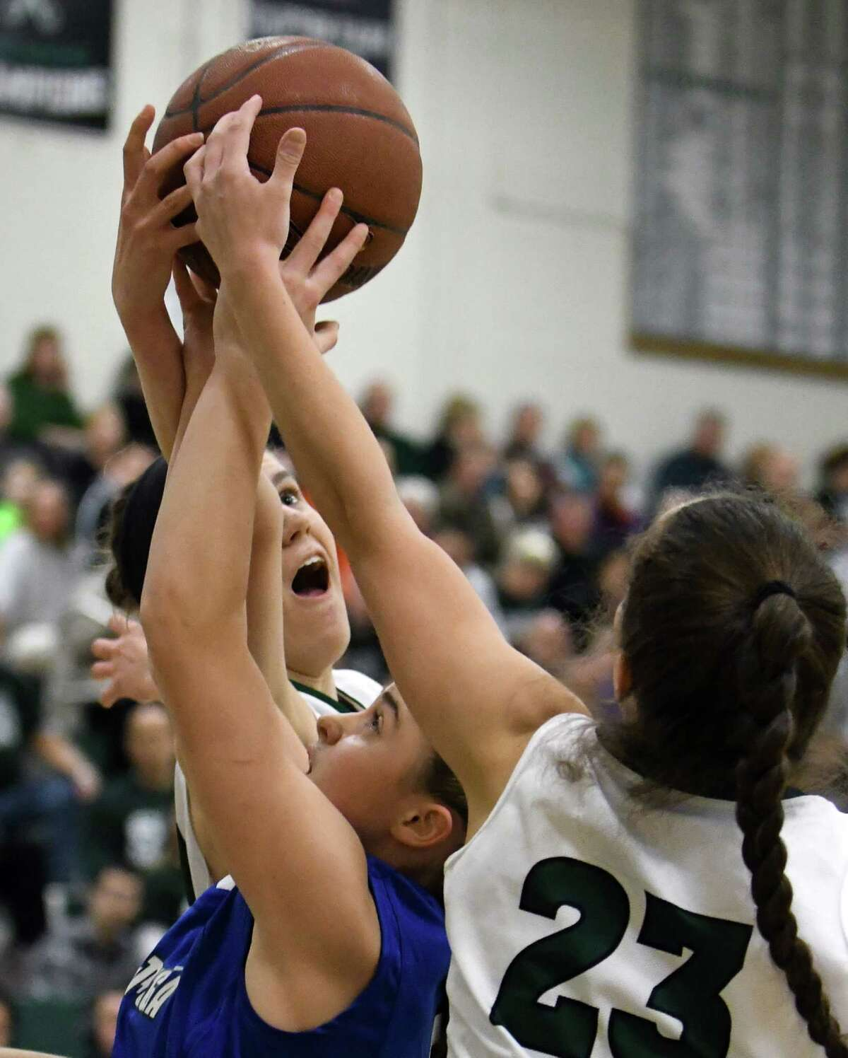 Shen's Alex Tudor and Cam Tooley battle for a rebound with Saratoga's Kara Vamvalis during their girl's high school basketball game on Wednesday Dec. 21, 2016 in Clifton Park, N.Y. (Michael P. Farrell/Times Union)