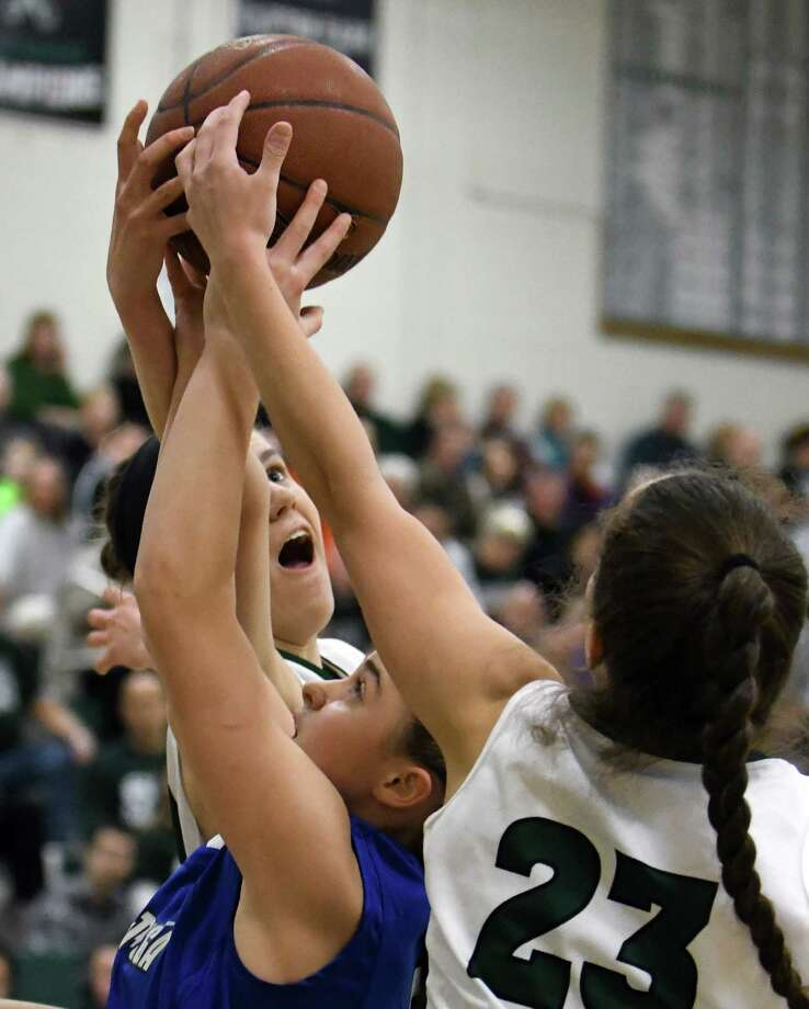 Shen's Alex Tudor and Cam Tooley battle for a rebound with Saratoga's Kara Vamvalis during their girl's high school basketball game on Wednesday Dec. 21, 2016 in Clifton Park, N.Y. (Michael P. Farrell/Times Union) Photo: Michael P. Farrell / 20039184A