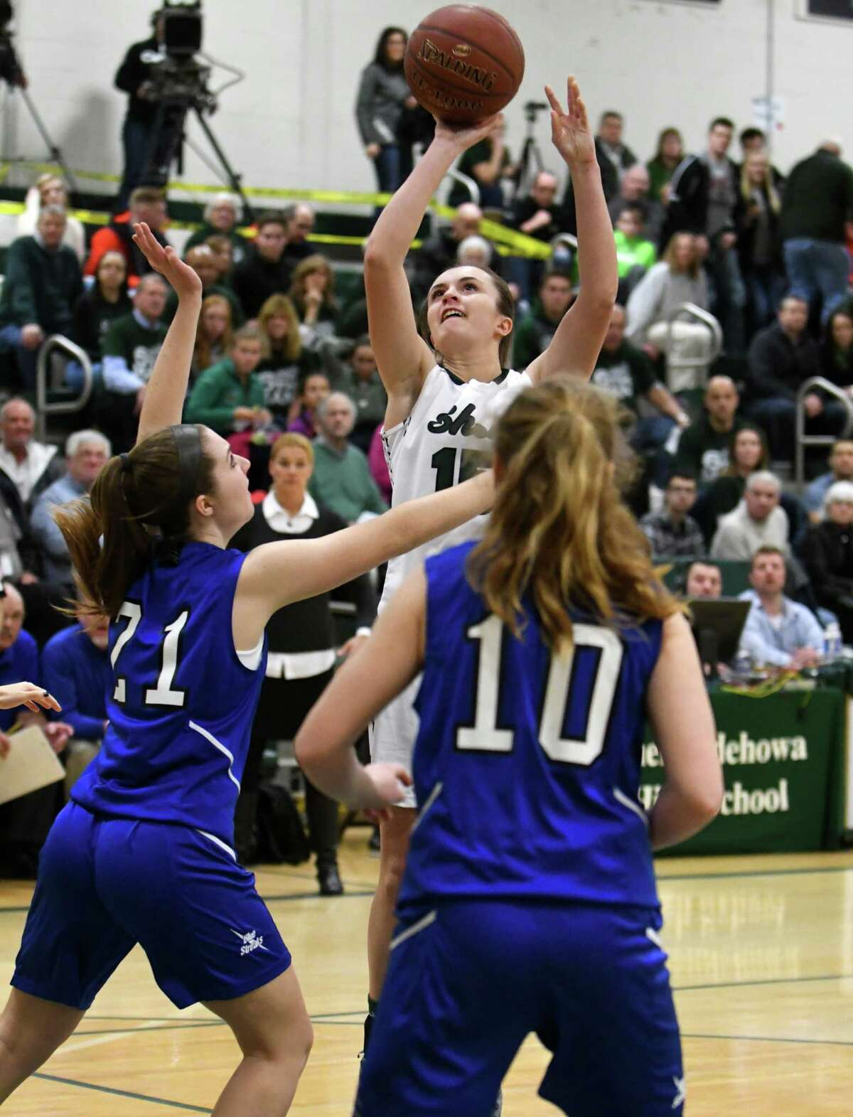 Shen's Megan Gillooley puts up a shot during their girl's high school basketball game against Saratoga on Wednesday Dec. 21, 2016 in Clifton Park, N.Y. (Michael P. Farrell/Times Union)
