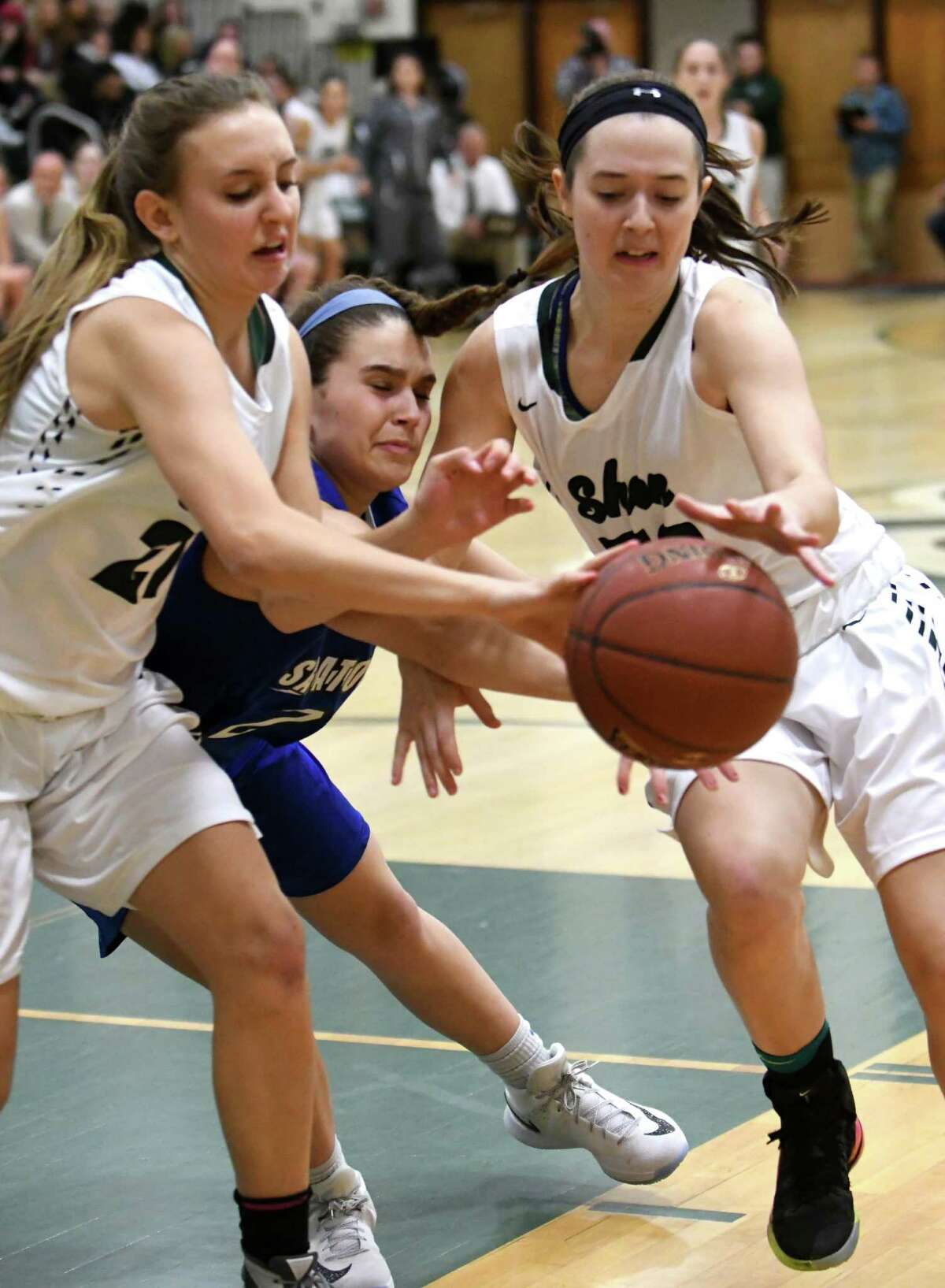 Shen's Anna Milham and Alexa Knudsen battle for a rebound with Saratoga's Kara Vamvalis during their girl's high school basketball game on Wednesday Dec. 21, 2016 in Clifton Park, N.Y. (Michael P. Farrell/Times Union)