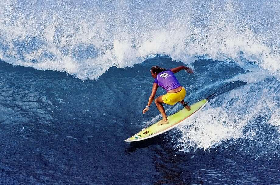 Layne Beachley, of Australia, rides a wave to seal her fourth consecutive Association of Surfing Professionals world championship title after all five of her rivals were eliminated from the Billabong Pro Maui surfing championship in Maui, hawaii, Monday, Dec. 3, 2001 our event. She retained her title when her closest challengerHeather Clark was defeated in the semi-finals.  Beachley finished tied for fifth in the tournament. (AP Photo/Pierre Tostee, ASP) Photo: PIERRE TOSTEE, Associated Press