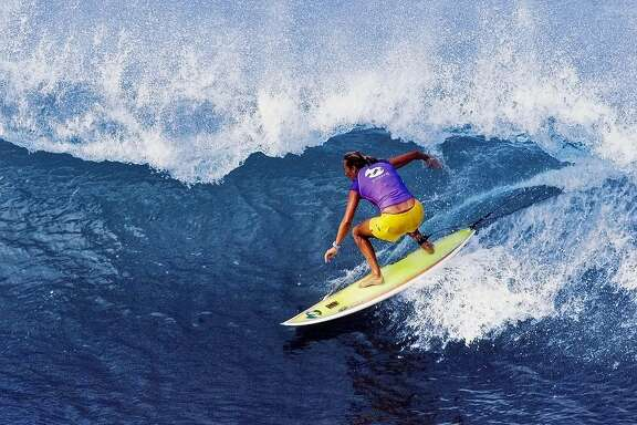 Layne Beachley, of Australia, rides a wave to seal her fourth consecutive Association of Surfing Professionals world championship title after all five of her rivals were eliminated from the Billabong Pro Maui surfing championship in Maui, hawaii, Monday, Dec. 3, 2001 our event. She retained her title when her closest challengerHeather Clark was defeated in the semi-finals.  Beachley finished tied for fifth in the tournament. (AP Photo/Pierre Tostee, ASP)