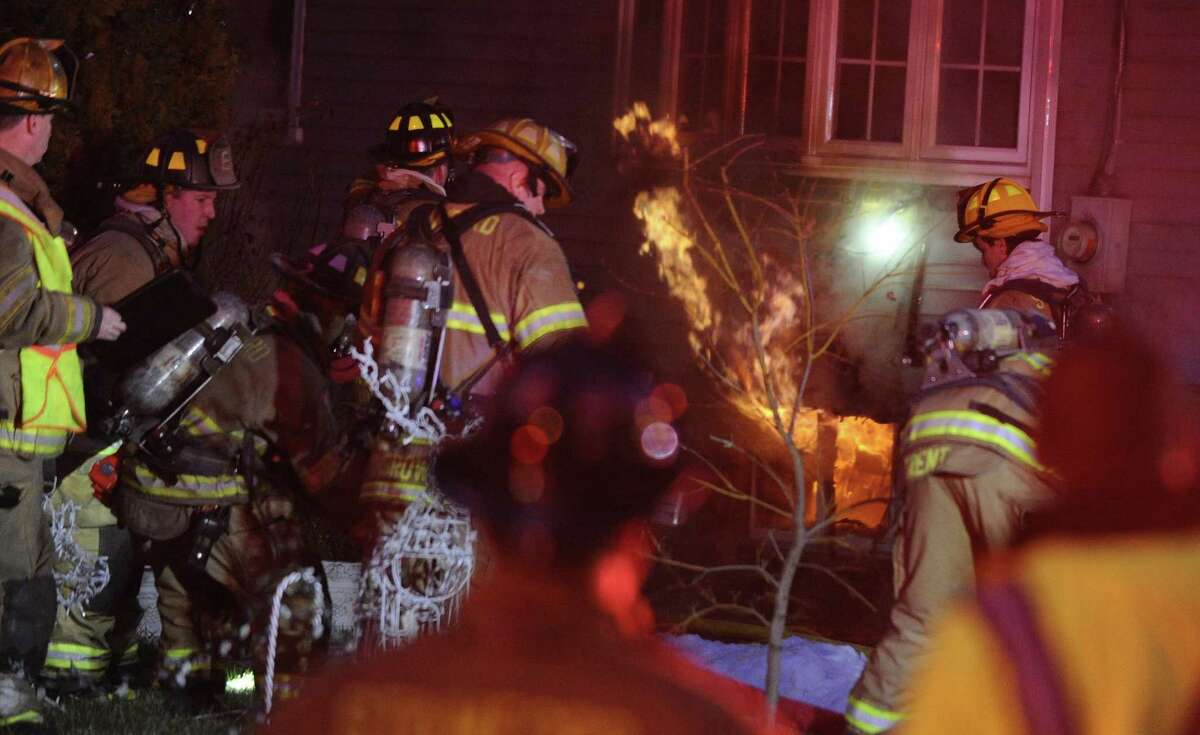 Emergency responders work the scene of a two alarm fire in the basement at 26 Underhill Street in Stamford on Dec. 21, 2016.