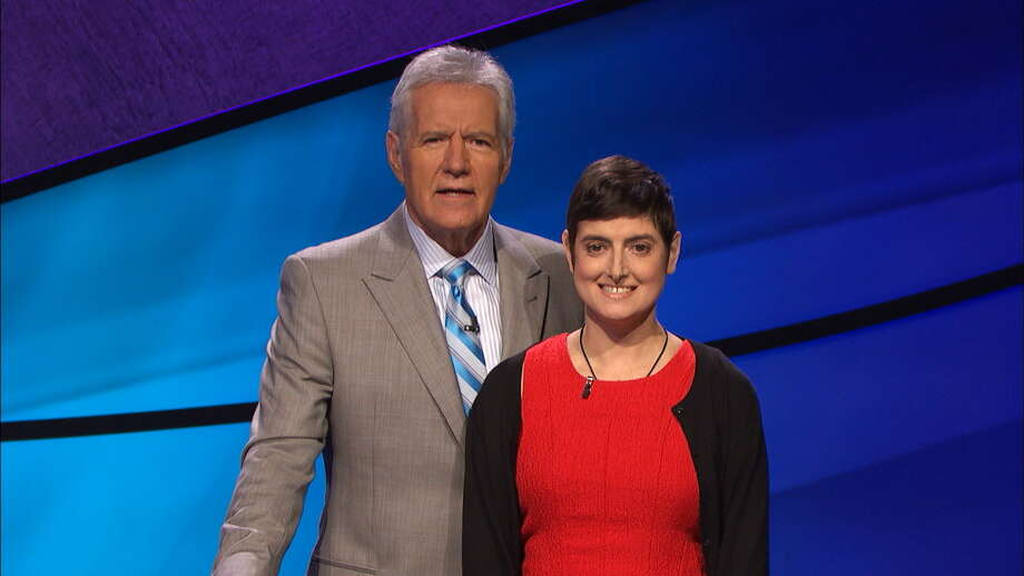 """In this Aug. 31, 2016 photo provided by Jeopardy Productions, Inc., Cindy Stowell, right, appears on the """"Jeopardy!"""" set with Alex Trebek in Culver City, Calif. Stowell, who died of cancer just days before her appearance on """"Jeopardy!"""" aired won six contests in a row and more than $103,000, some of which has been donated toward cancer research. Stowell's run ended when she finished second in her seventh appearance that aired on Wednesday, Dec. 21. (Courtesy of Jeopardy Productions, Inc. via AP) ORG XMIT: NYAG101 / Jeopardy Productions, Inc"""