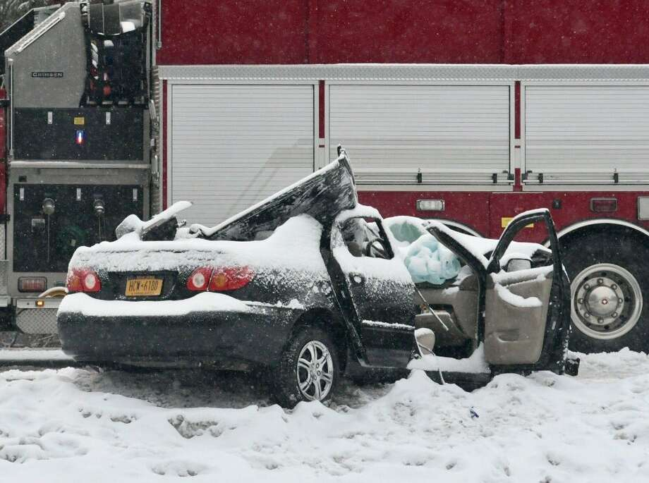 A car was badly damaged and the driver injured when police said the vehicle collided with a state snow plow on the Northway Thursday morning near Exit 15 in Saratoga Springs. (Skip Dickstein / Times Union)