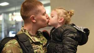 Christopher Madigan kisses his niece Alexis Madigan, 2, of Melrose after arriving home at the Albany International Airport on Tuesday, Dec. 20, 2016 in Colonie, N.Y. Madigan joined the Army in September and is home for Christmas from Fort Sill, Oklahoma. (Lori Van Buren / Times Union)