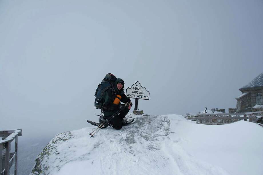 Outdoors writer Herb Terns models a backpack full of the recommended gear for winter mountaineering during a 2014 trip up Whiteface Mountain in the Adirondack High Peaks. (Photo courtesy Gillian Scott) Photo: Picasa