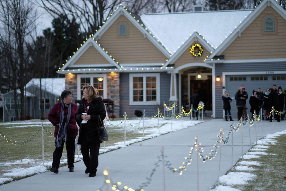 Photo provided: Cobblestone Homes hosted its 3rd Annual Homes for  the Holidays event on Dec. 9. The event raised money to support the MidMichigan Medical Center-Midland Oncology Department.