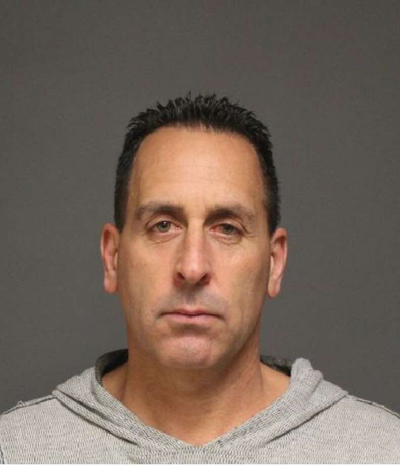 Robert Santillo, 51, of Orange, was charged with two counts of issuing a bad check in Fairfield, Conn. on Dec. 12, 2016. Photo: Fairfield Police / Contributed Photo / Fairfield Citizen