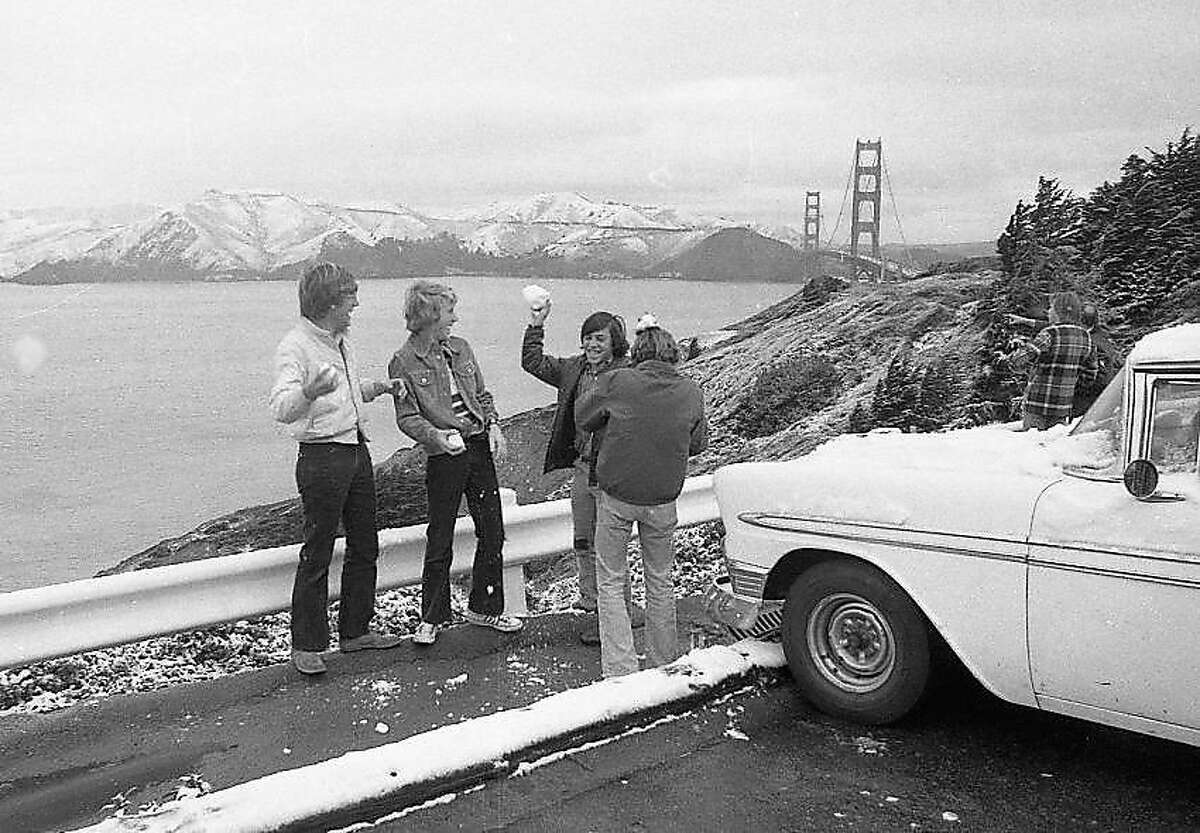 Kids mess around with snowballs near Lands End in San Francisco. Mt. Tamalpais is covered with snow in the background, during the rare snow day in the Bay Area. File photo from Feb. 5, 1976. (Clem Albers/Hearst)
