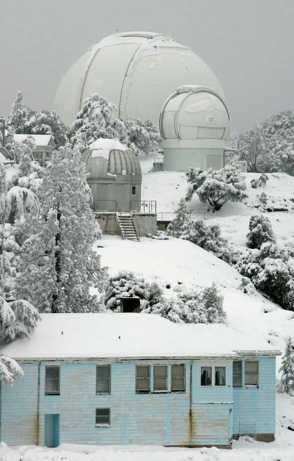 High-powered telescopes are covered in snow left by a winter storm at the Lick Observatory on Mt. Hamilton in San Jose, Calif., Wednesday, Jan. 23, 2008.(AP Photo/Marcio Jose Sanchez) Photo: Marcio Jose Sanchez/AP