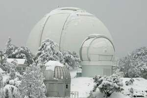 High-powered telescopes are covered in snow left by a winter storm at the Lick Observatory on Mt. Hamilton in San Jose, Calif., Wednesday, Jan. 23, 2008.(AP Photo/Marcio Jose Sanchez)