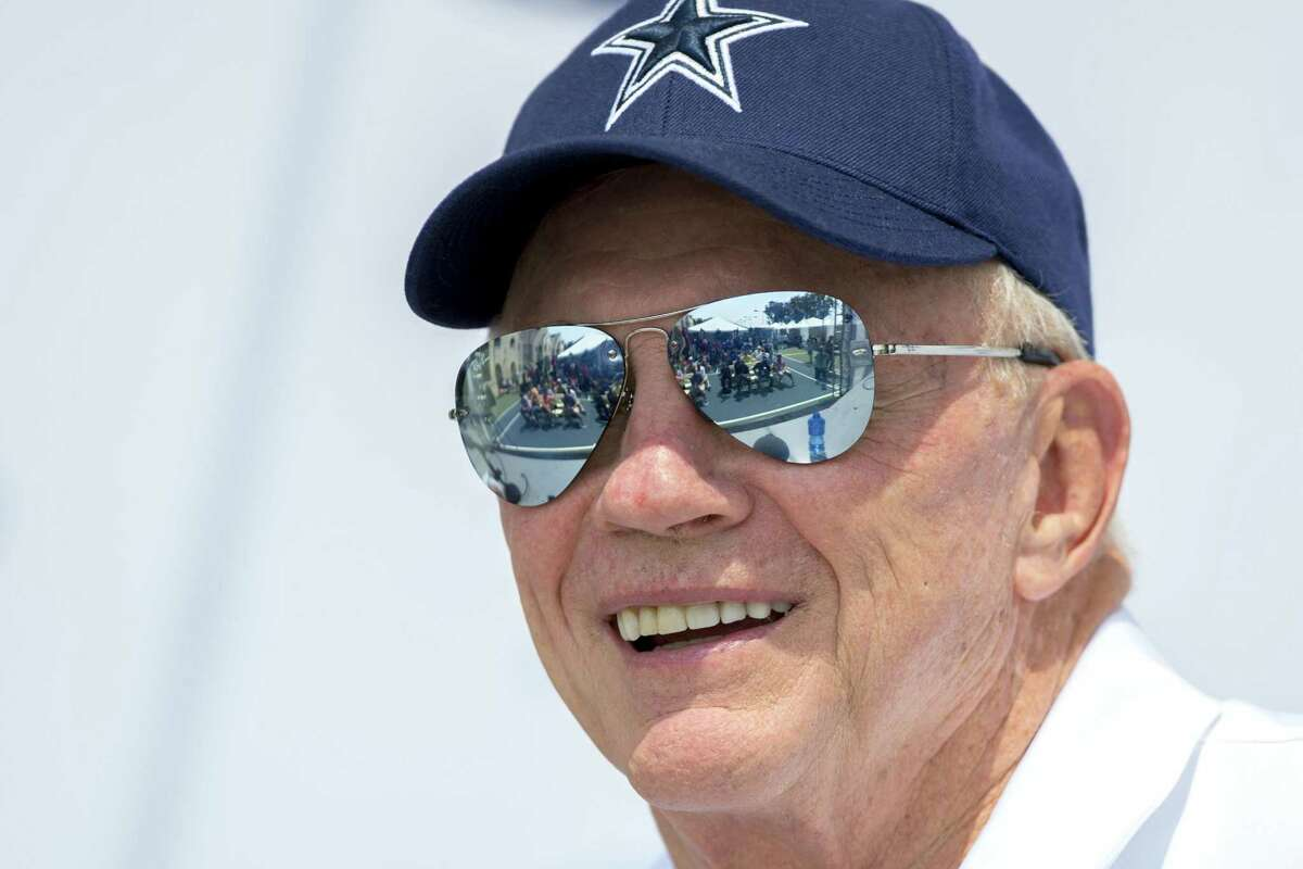 Dallas Cowboys owner Jerry Jones answers a question during the