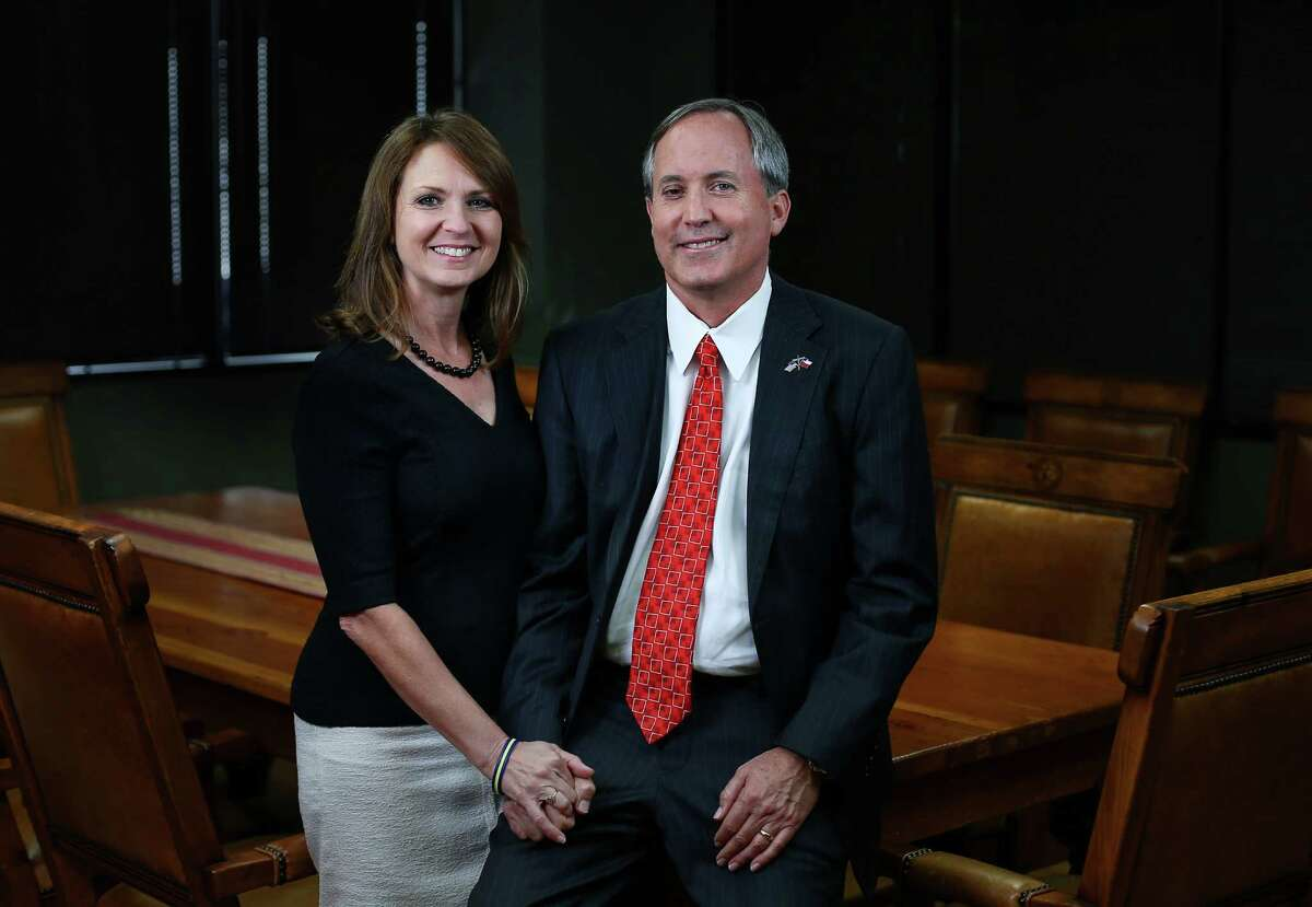 Texas Attorney General Ken Paxton, right, and his wife, Angela Paxton, pose for a portrait Wednesday, Sept. 21, 2016, in Austin.