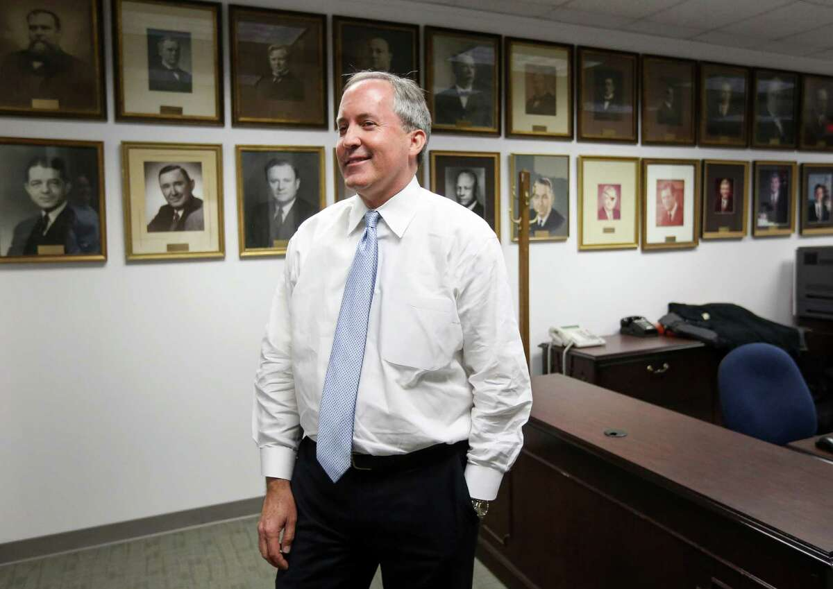 Texas Attorney General Ken Paxton is seen in his office Friday, Oct. 21, 2016, in Austin.