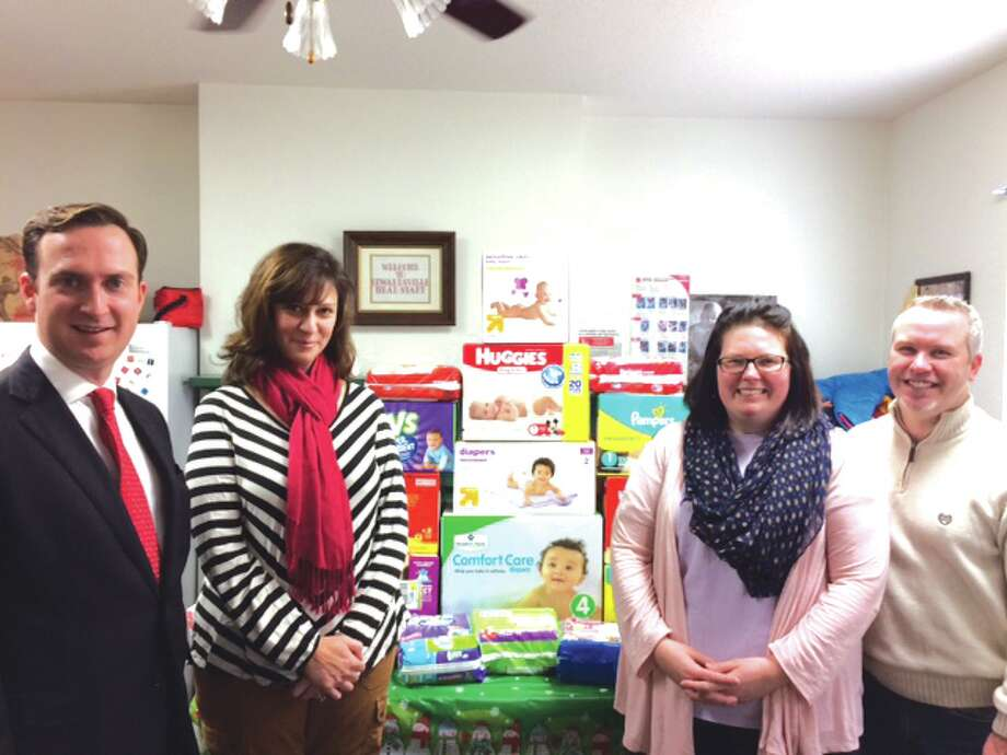 Christmas came early for the Riverbend Head Start program as the Edwardsville Rotary Club delivered 20 boxes of diapers for the families in the program. Pictured are, from left: Rotarians Brian Pezza and Sarah Palermo, Head start Director Kelly Barrett, and Rotarian Mark Fryer. Photo: For The Intelligencer
