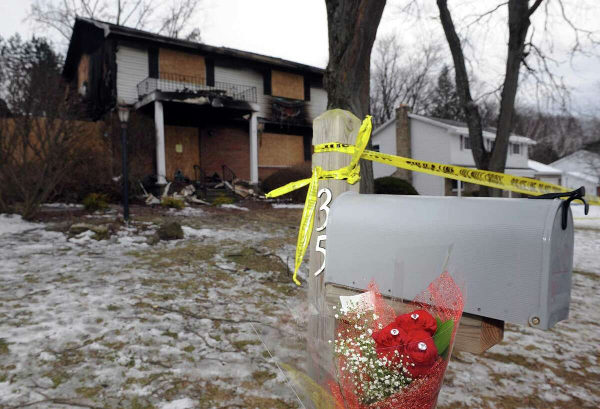 Roses left in front of Roman home at 35 Schalren Drive on Friday afternoon, Feb. 12, 2016, in Colonie, N.Y. Colonie Police Officer Israel J. Roman shot and killed his wife and 10-year-old son, carried their bodies upstairs to the master bedroom, started a fire at their Schalren Drive home and turned his Smith & Wesson .45-caliber service revolver on himself Tuesday afternoon. (Michael P. Farrell/Times Union)
