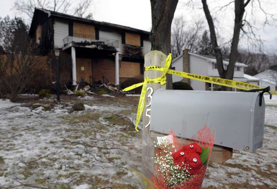 Roses left in front of Roman home at 35 Schalren Drive on Friday afternoon, Feb. 12, 2016, in Colonie, N.Y. Colonie Police Officer Israel J. Roman shot and killed his wife and 10-year-old son, carried their bodies upstairs to the master bedroom, started a fire at their Schalren Drive home and turned his Smith & Wesson .45-caliber service revolver on himself Tuesday afternoon. (Michael P. Farrell/Times Union) Photo: Michael P. Farrell / 10035426A