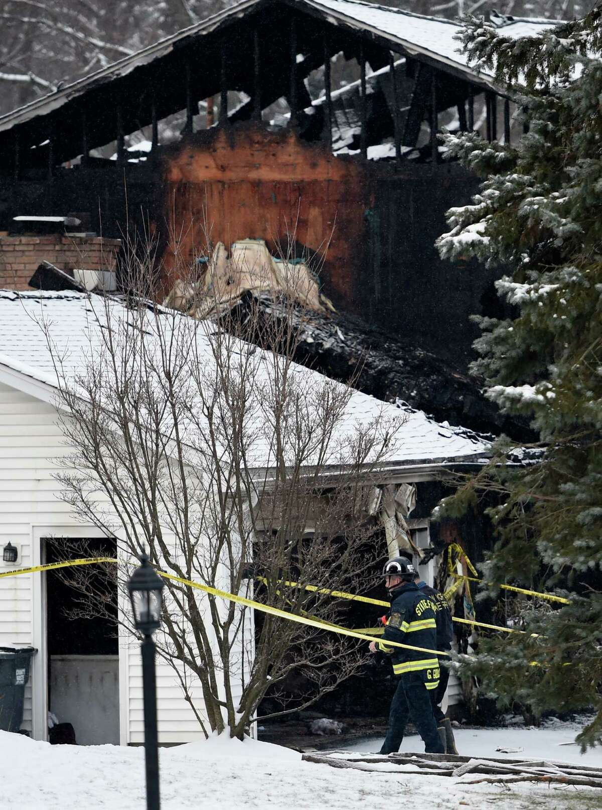 Law enforcement on the local and state level investigate a fatal fire Wednesday morning, Feb. 10, 2016, involving a Colonie Police officer and his family at 35 Schalren Dr. early Tuesday in Colonie, N.Y. (Skip Dickstein/Times Union)