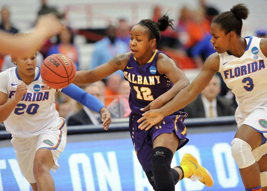 University at Albany's Imani Tate, center, drives to the basket against Florida players during the first round of the NCAA women's basketball tournament at the Carrier Dome on Friday, March 18, 2016 in Syracuse, N.Y.  (Lori Van Buren / Times Union) Photo: Lori Van Buren