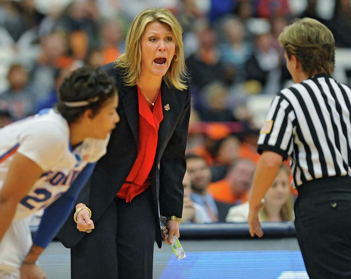 University at Albany Head Coach Katie Abrahamson-Henderson screams at a referee during a match against Florida during the first round of the NCAA women's basketball tournament at the Carrier Dome on Friday, March 18, 2016 in Syracuse, N.Y. (Lori Van Buren / Times Union)