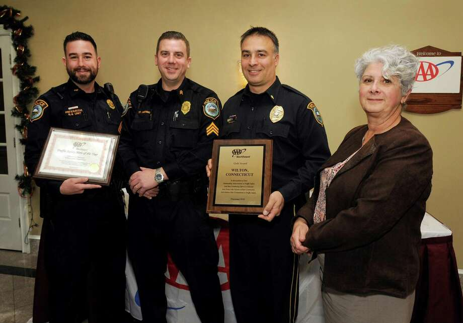 At AAA's 7th Annual Community Traffic Safety Awards lunch recently at Testo's in Bridgeport, Public Affairs Manager Fran Mayko, right, presented the awards to, from left, Officer Patenaude; Sgt. David Hartman, who is a AAA Driving Improvement Instructor; and Lieut. Robert Kluk. Photo: Contributed Photo
