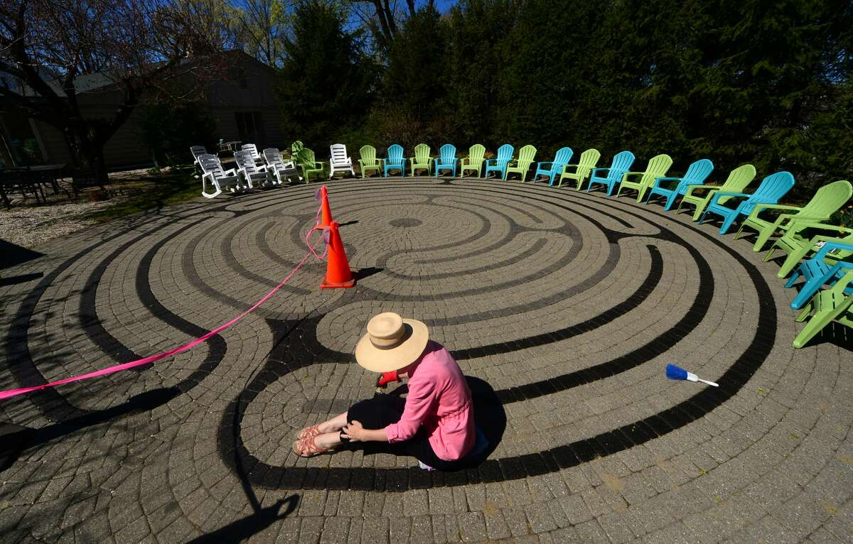 Parishioner and Earth Day event coordinator, Audrey Cozzarin, repaints the Labyrinth at St. Paul's on the Green Episcopal Church in Norwalk, Connecticut on the morning of Wednesday, April 20, 2016, in preparation for the church's Earth Day celebration this Saturday.