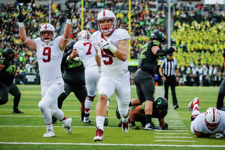 """FILE - In this Nov. 12, 2016, file photo, Stanford running back Christian McCaffrey (5) runs for a touchdown in the first quarter of an NCAA college football game, in Eugene, Ore. McCaffrey is done playing college football. Stanford's star running back announced on Twitter on Monday, Dec. 19, 2016,  that he will not play in the 16th-ranked Cardinal's Sun Bowl game against North Carolina (8-4) on Dec. 30 in El Paso, Texas. """"Very tough decision, but I have decided not to play in the Sun Bowl so I can begin my draft prep immediately,"""" McCaffrey said. (AP Photo/Thomas Boyd, File) Photo: Thomas Boyd, FRE / AP Photo"""