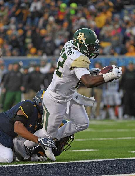 MORGANTOWN, WV - DECEMBER 03:  Terence Williams #22 of the Baylor Bears dives into the end zone for a 9 yard touchdown run in the second quarter during the game against the West Virginia Mountaineers at Mountaineer Field on December 3, 2016 in Morgantown, West Virginia. (Photo by Justin Berl/Getty Images) Photo: Justin Berl, Stringer / 2016 Getty Images
