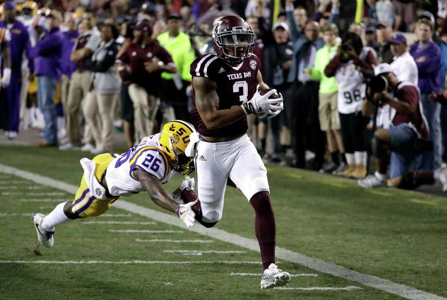 Texas A&M wide receiver Christian Kirk (3) runs to the end zone with a touchdown reception as LSU safety John Battle (26) defends during the first quarter of an NCAA college football game Thursday, Nov. 24, 2016, in College Station, Texas. (AP Photo/David J. Phillip) Photo: David J. Phillip, STF / Copyright 2016 The Associated Press. All rights reserved.