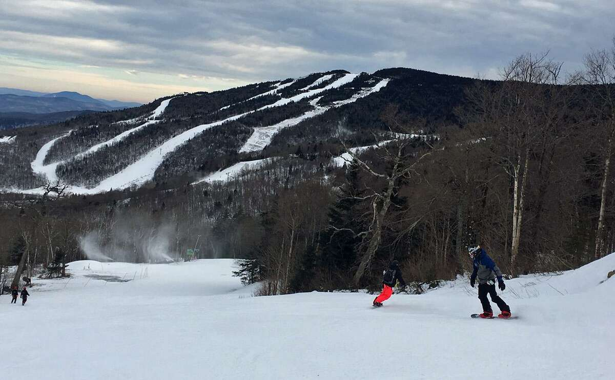 A skier goes down the Caper trail from the summit of Ramshead Mountain at Killington, Vermont on Tuesday, Dec. 20, 2016. In the distance is Killington's Skye Peak trails. Vermont areas have ramped up their snowmaking in preparation for the busy Christmas/New Year's holiday week.