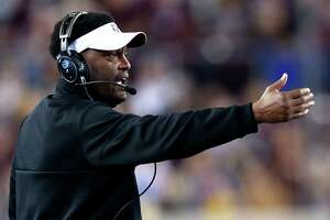 Texas A&M head coach Kevin Sumlin makes a call from the sidelines during the second quarter of an NCAA football game against LSU at Kyle Field on Thursday, Nov. 24, 2016, in Houston. ( Brett Coomer / Houston Chronicle )