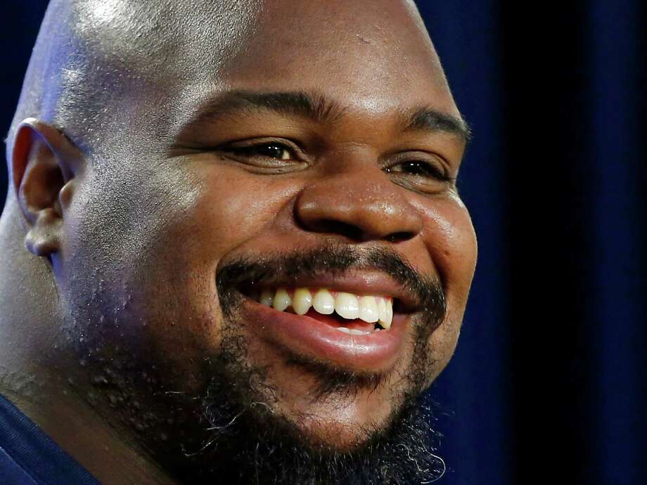 FILE - In this Jan. 23, 2015, file photo, New England Patriots football defensive tackle Vince Wilfork smiles during a news conference in Foxborough, Mass. Wilfork, who won two Super Bowls with the Patriots, said Thursday, March 5, 2015, the team will not be picking up his option and he will become a free agent.  (AP Photo/Elise Amendola, File) Photo: Elise Amendola, STF / AP