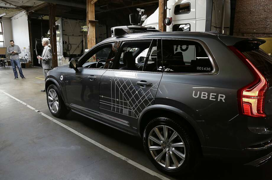 An Uber driverless car is displayed in a garage in San Francisco in December. Uber said Thursday it is working on an application for a California self-driving car permit — two months after the company publicly refused to do so and moved its autonomous vehicles from San Francisco to Arizona. Photo: Eric Risberg, Associated Press