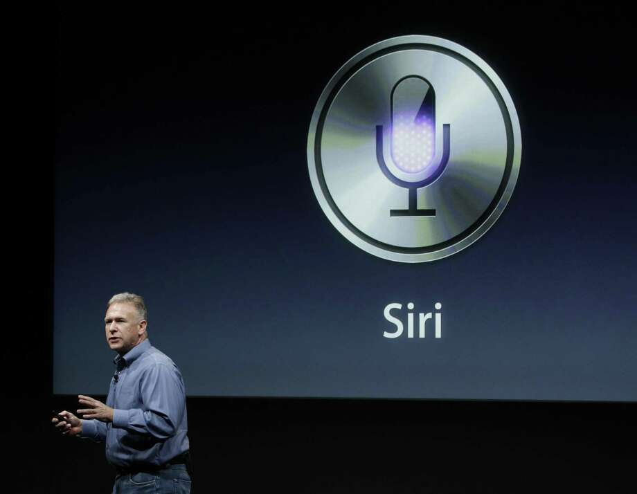 Apple's Phil Schiller talks about Siri during a 2011 announcement at Apple headquarters in Cupertino, Calif. Photo: Paul Sakuma / Associated Press / AP