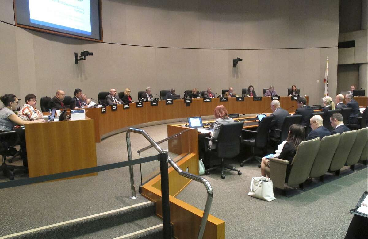 In this Monday, Dec. 19, 2016, photo, members of the California Public Employees' Retirement System, CalPERS listen to discussion about reinvesting in tobacco stocks in Sacramento, Calif. (AP Photo/Jonathan J. Cooper, File)