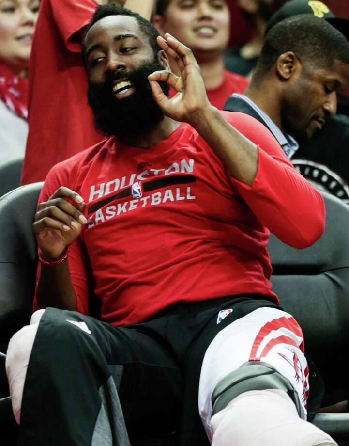 Houston Rockets guard James Harden (13) reacts after  Rockets forward Kyle Wiltjer (30) scored a 3-pointer against the Sacramento Kings during the second half of an NBA basketball game at Toyota Center on Wednesday, Dec. 14, 2016, in Houston. ( Brett Coomer / Houston Chronicle ) Photo: Brett Coomer, Staff / © 2016 Houston Chronicle