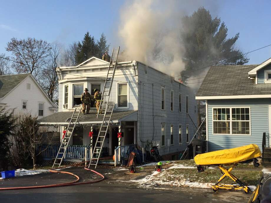 Firefighters battle a fully-involved house fire at 24 Woodland Ct. in South Troy on at 1:30 p.m. Dec. 22, 2016. (Skip Dickstein)
